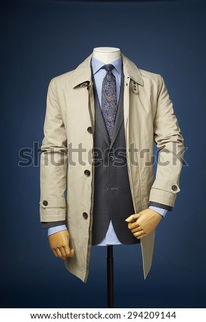 man jacket on a manequin isolated on a blue background.
