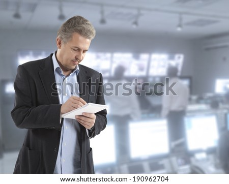 Man journalist writing letter on the notepad