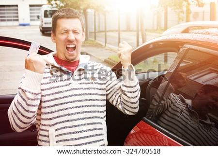 man joy new cars  - stock photo