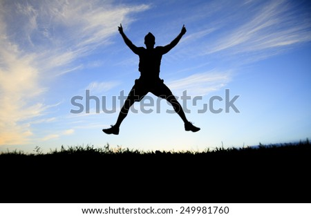 Man jump on the sunset day time. - stock photo