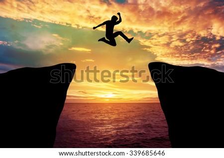 Man jump through gap between hill stock photo 339685646 for Jump the gap