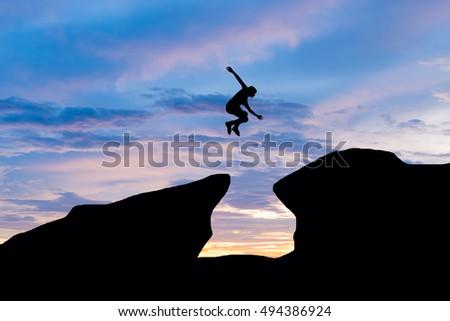 Silhouette trekkers flag peak mountain morning stock photo for Jump the gap