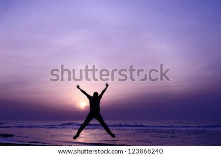 Man jump through the gap. sig of success - stock photo