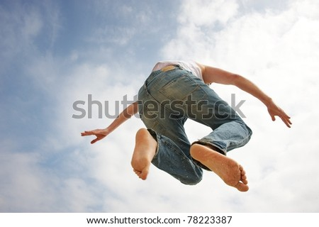 Man jumping against blue sky - stock photo