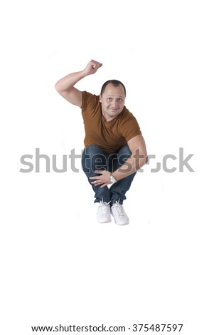 Man jumping and smiling. Studio photography, isolated on white background