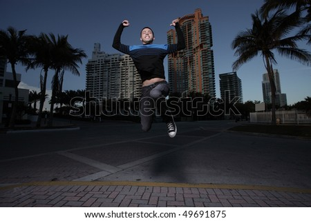 Man jumping for joy - stock photo
