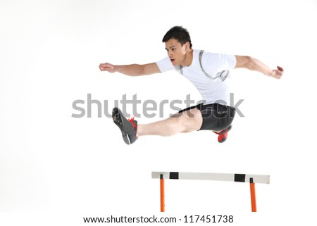 Man jumping hurdle