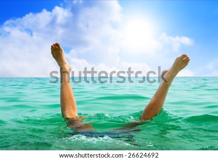 man jumping in ocean - stock photo