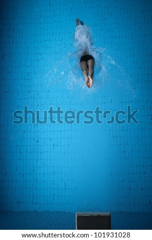 man jumping in pool - stock photo