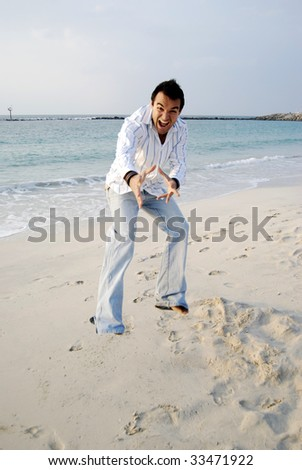 Man jumping in the beach with energy