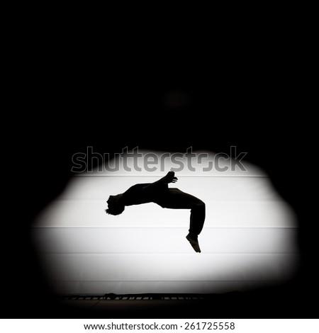 man jumping on trampoline  - stock photo