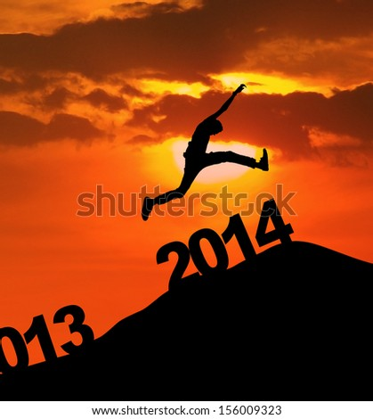 Man jumping over 2014 number to embrace the new year