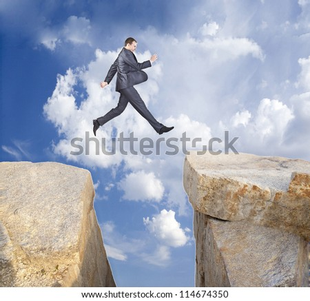 Man  jumping over the mountains - stock photo