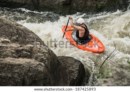 Man kayaking down whitewater
