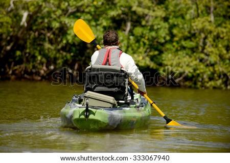 man kayaking in mangroves in florida - stock photo