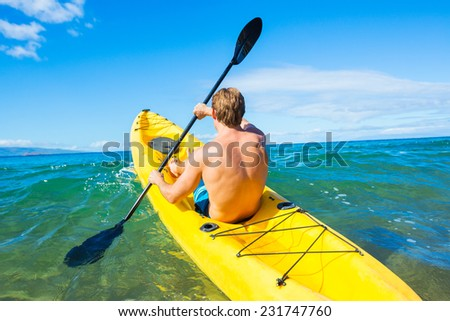 Man Kayaking in the Tropical Ocean - stock photo