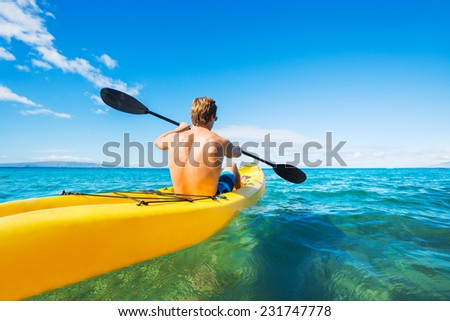 Couple kayaking ocean on vacation stock photo 231784690 for Tropical vacations for couples