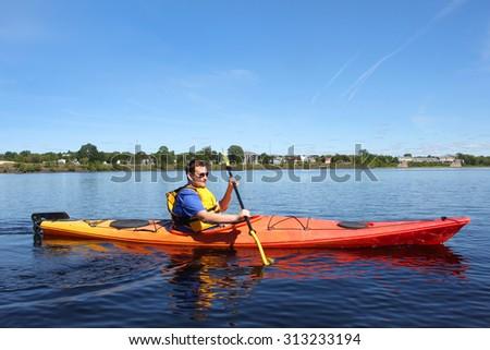 Man kayaking on the Saint John River  in Fredericton, New Brunswick - stock photo