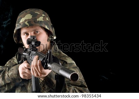 Man keeping a gun in studio. Isolated - stock photo