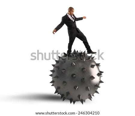 Man keeps the balance despite the crisis - stock photo