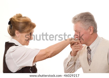 man kisses the hand of an elderly woman