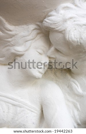 Man kissing a woman, statue, the art of saint valentine day - stock photo