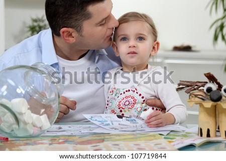 Man kissing his daughter - stock photo