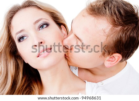 Man kissing his girlfriend on the neck - isolated over a white background