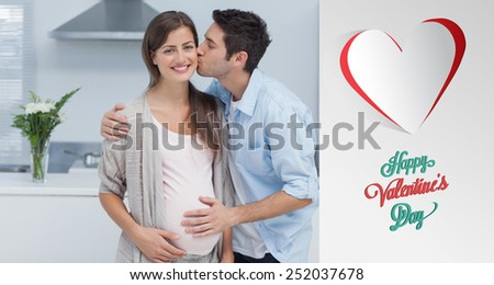 Man kissing his pregnant wife against cute valentines message - stock photo