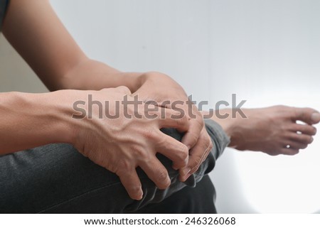 Man knee and ankle pain. - stock photo