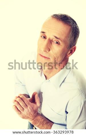 Man kneeling and praying to God - stock photo