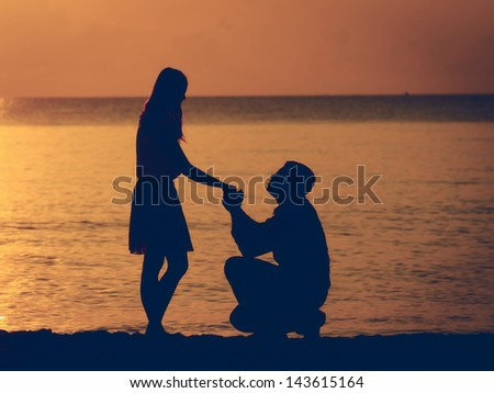 Man knees ask woman to marry - stock photo