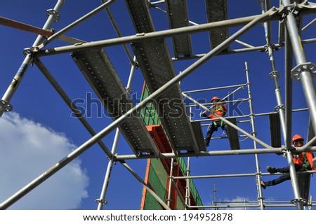 Man labor erection scaffolding - stock photo