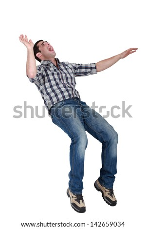 Man laughing his head off - stock photo