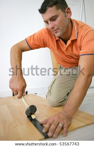 Man laying parquet - stock photo