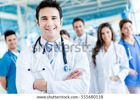 Man leading a group of doctors at the hospital  - stock photo