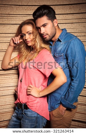 man leaning his head on his girlfrends shoulder while she is scratching her head - stock photo