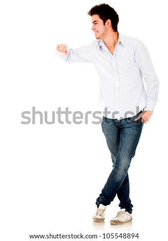 Man leaning on an imaginary object - isolated over a white background - stock photo
