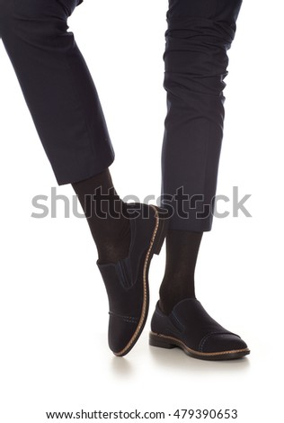 Man leg in suit and black socks, isolated on white