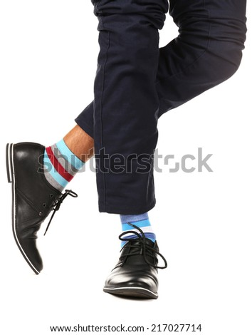 Man leg in suit and colorful socks, isolated on white  - stock photo