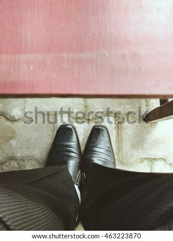 man legs in elegant shoes with table