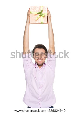 Man lifted present up isolated on white background. waist up of guy with present holding box up - stock photo