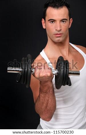 Man lifting dumbbell - stock photo