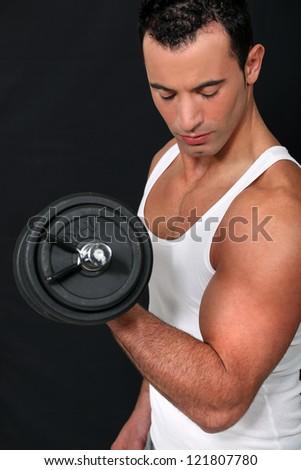 man lifting weight - stock photo