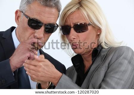 Man lighting cigar - stock photo