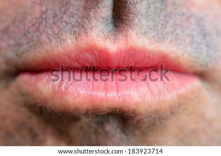 Man lips. full frame close up. Concept photo of male sexuality and skin medical care. - stock photo
