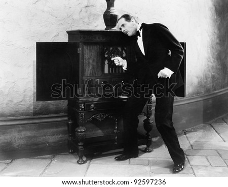 Man listening and dancing to music from a radio - stock photo