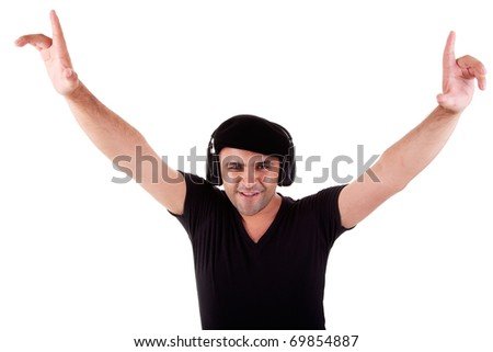 man listening music in headphones, arms raised, isolated on white background, studio shot - stock photo