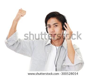 Man listening to music - stock photo