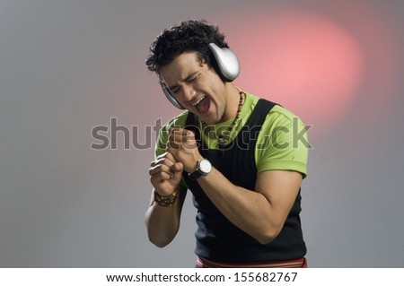Man listening to music and looking excited